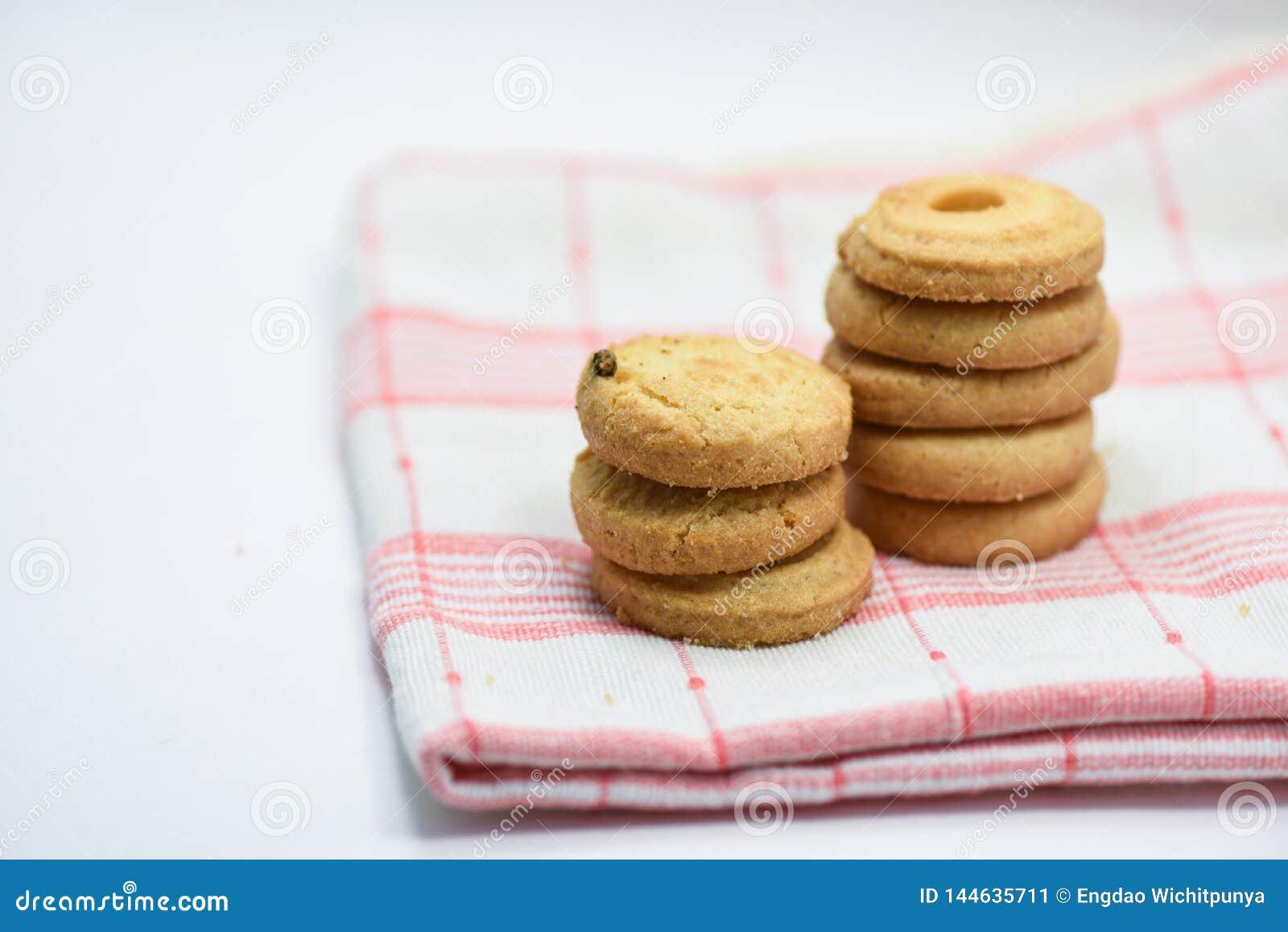 Boter de lijstdoek van het koekjesgebakje op witte achtergrond