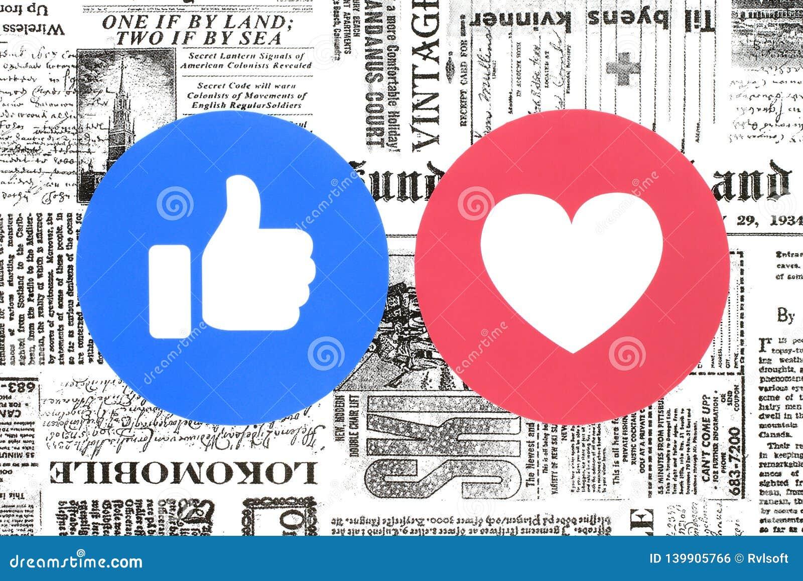 Botones del gusto y del amor de Facebook de las reacciones comprensivas de Emoji en el periódico