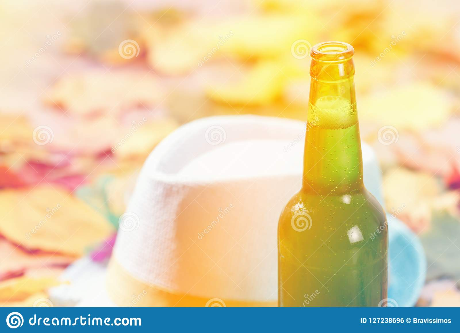 Bottle of Beer glass pint octoberfest picnic on natural background with hat and autumn leaves