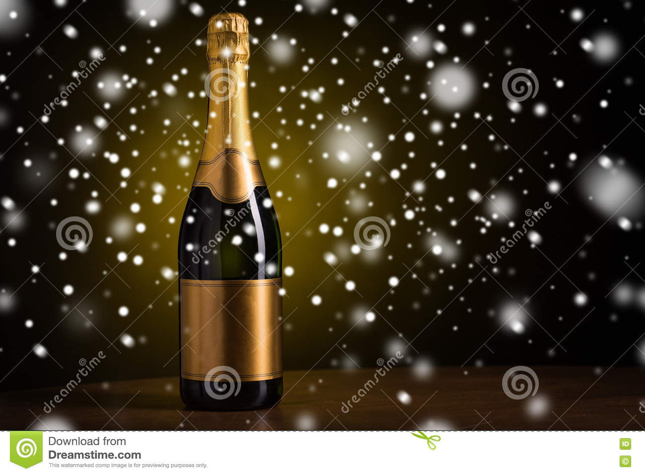 drink alcohol christmas new year and winter holidays concept bottle of champagne with blank golden label on wooden table over dark background and snow