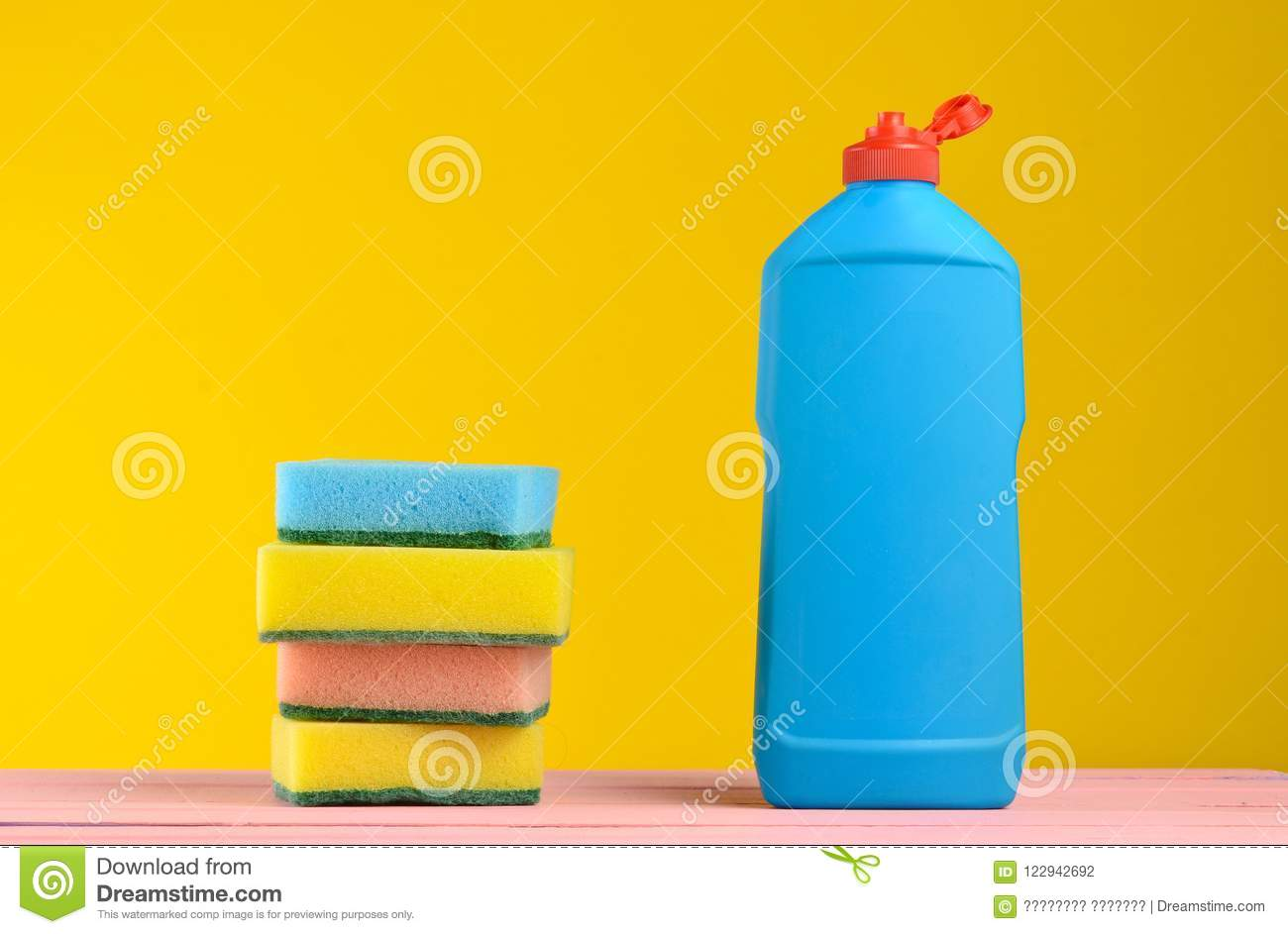 A Bottle Of Dish Washing, Sponges, On A Wooden Pastel Color Table ...