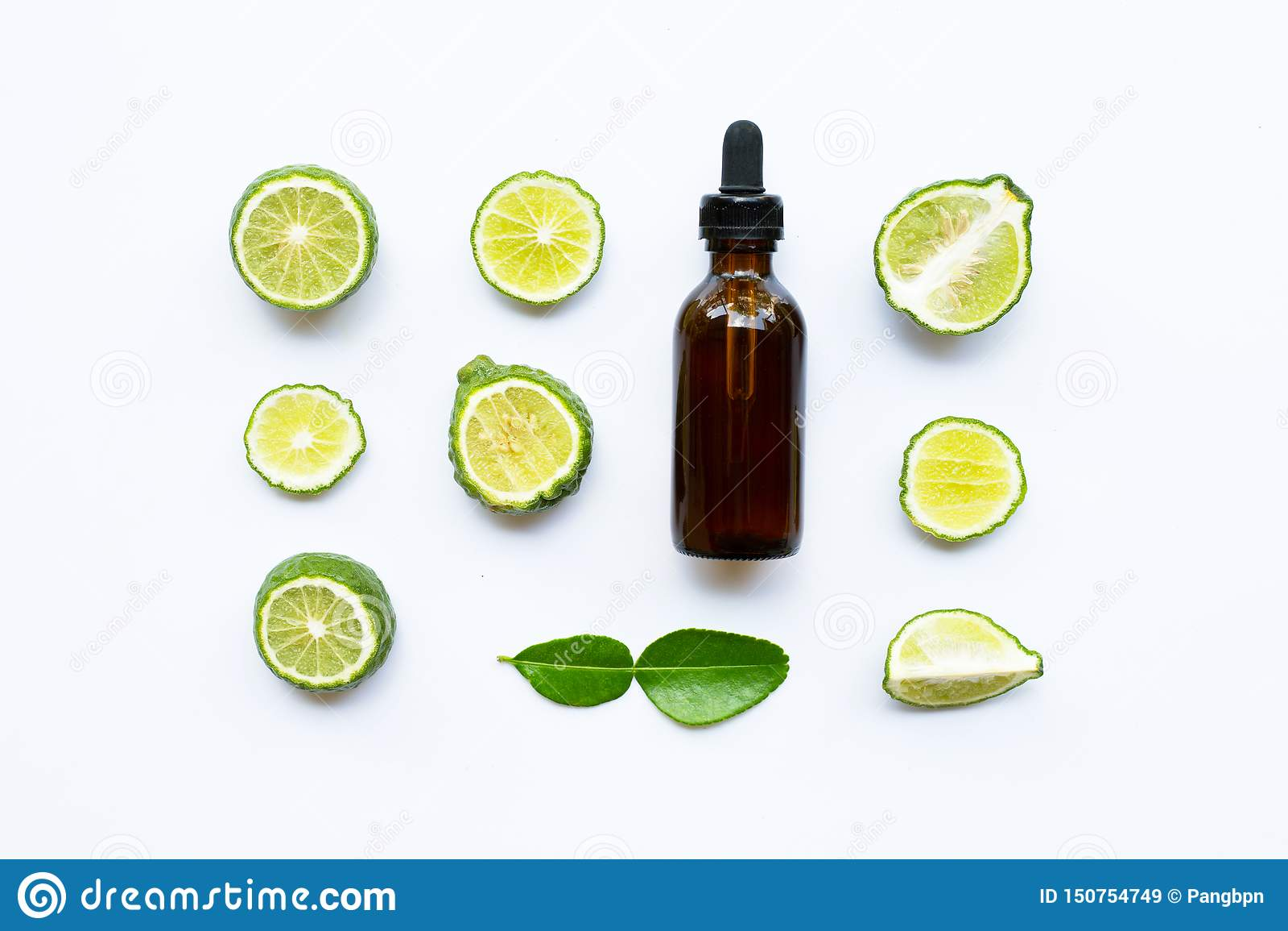 Bottle of essential oil and fresh kaffir lime or bergamot fruit isolated on white