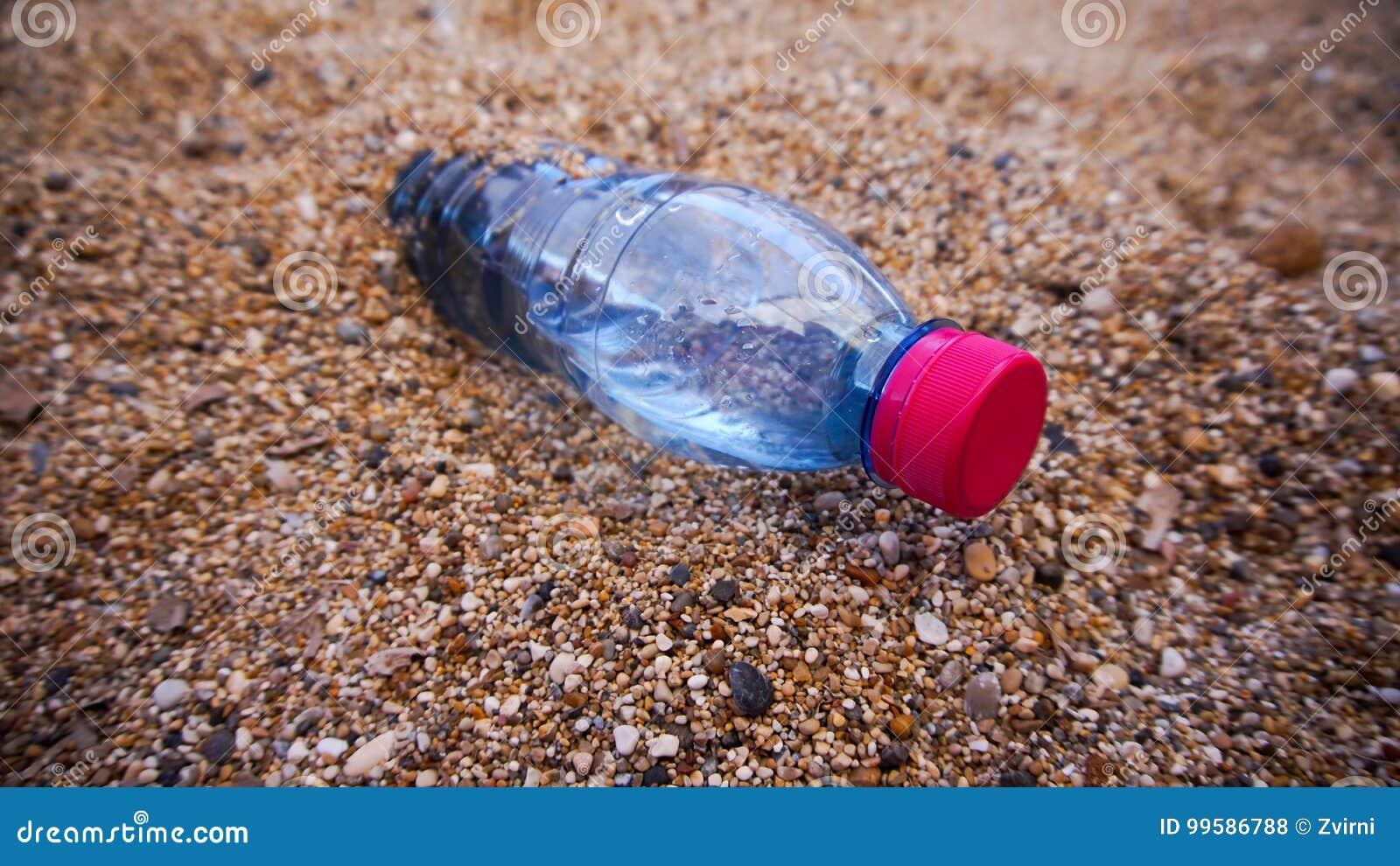 Plastic bottle in the sand
