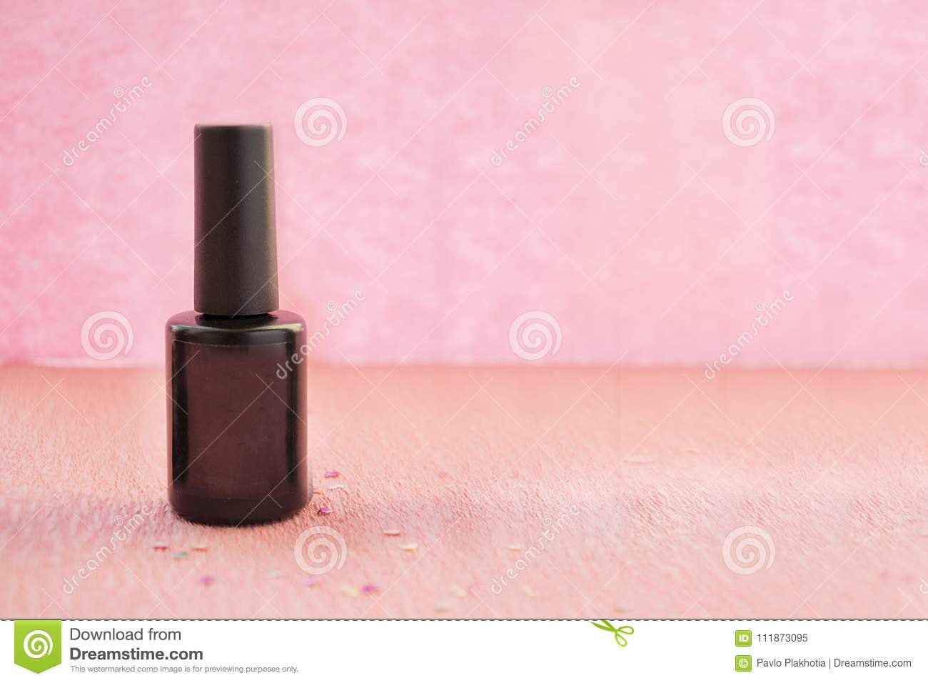 bottle of gel nail polish with template black label over pink