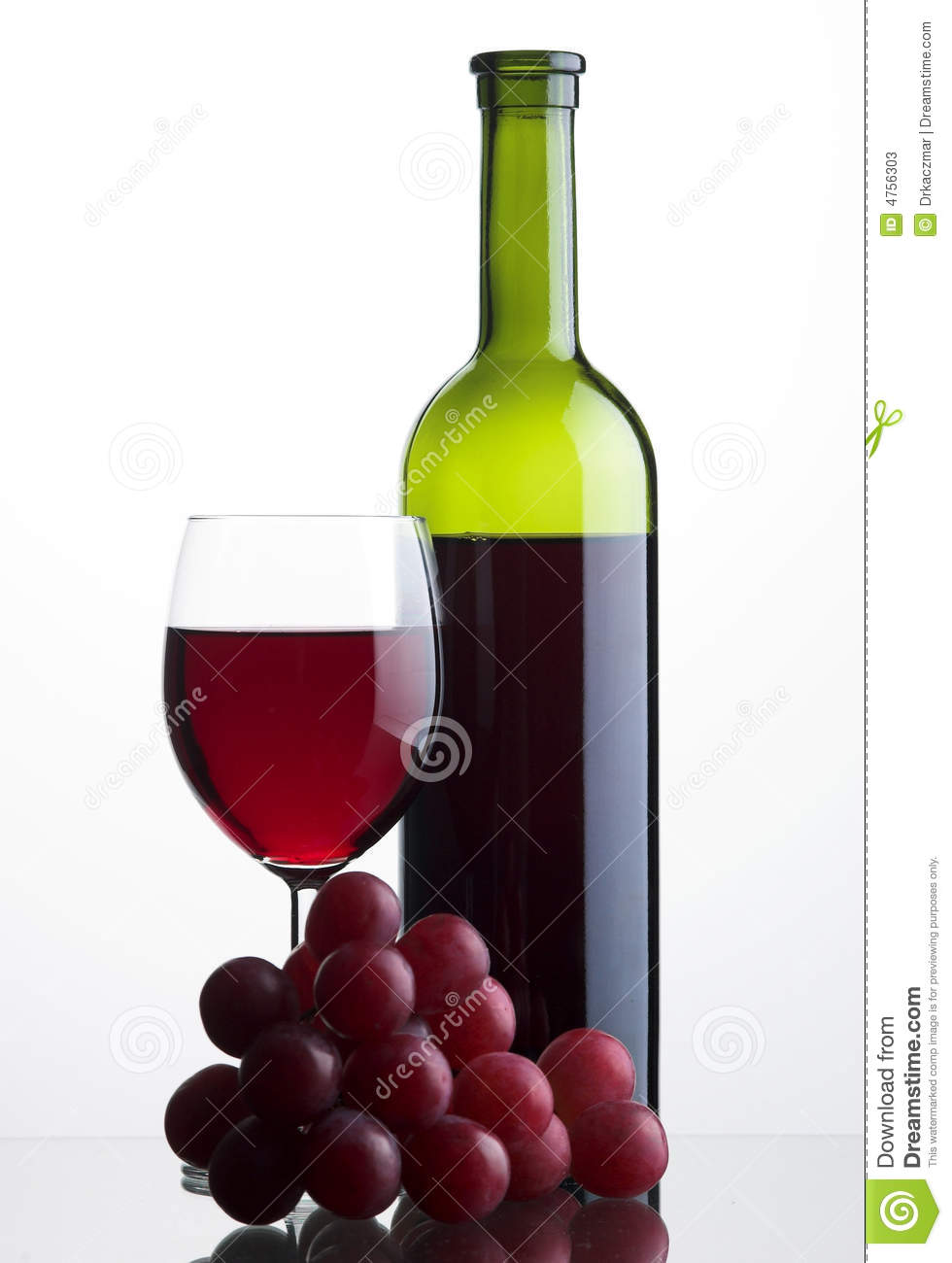 Bottle and glass of red wine with grapes stock photos for Wine bottle glass