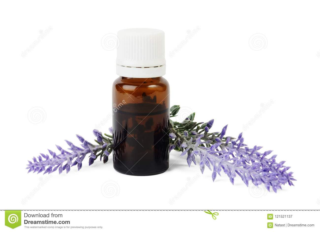 Bottle of organic essential oil and lavender flowers on white background