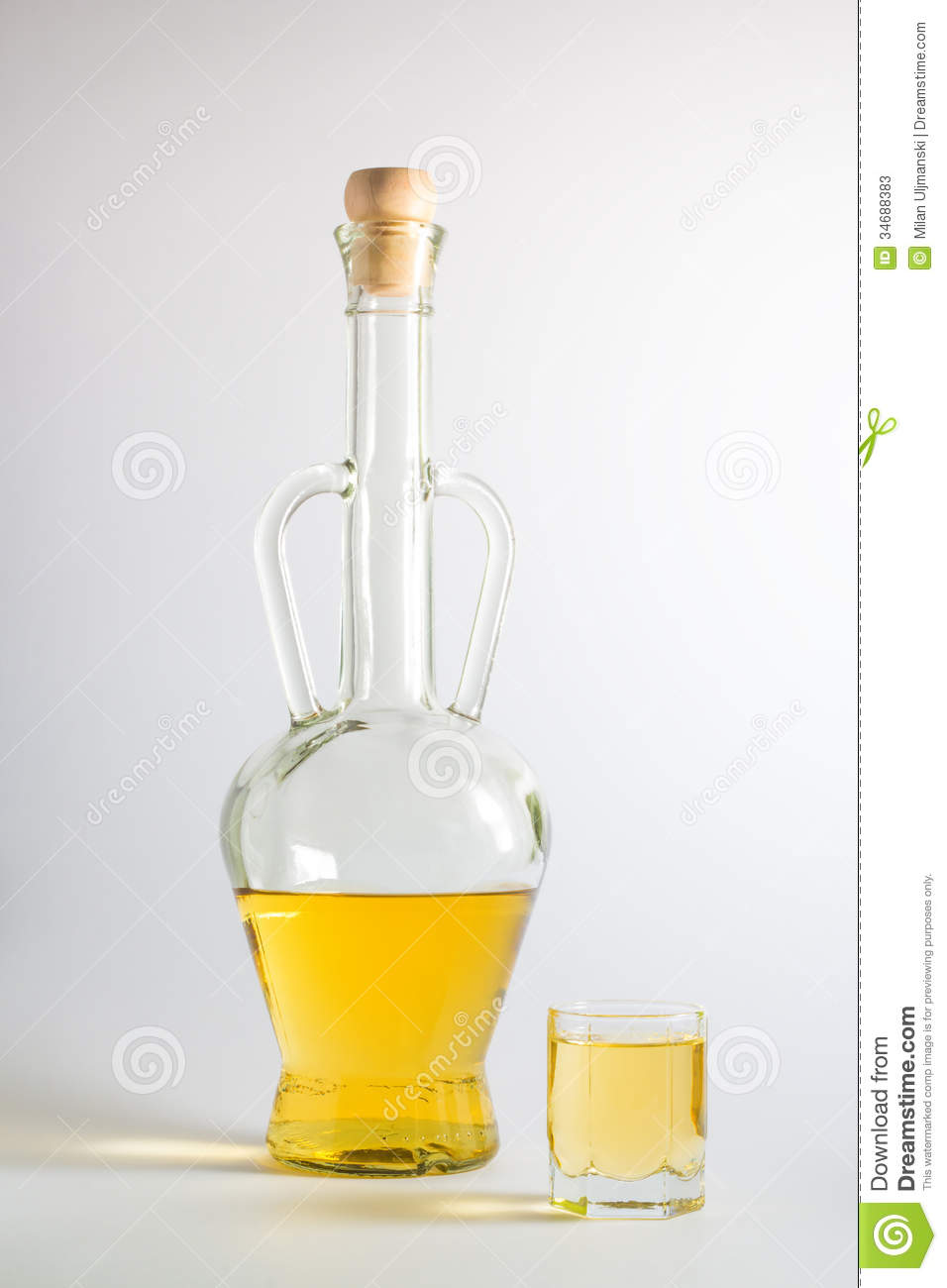 Bottle of Plum Brandy with a glass