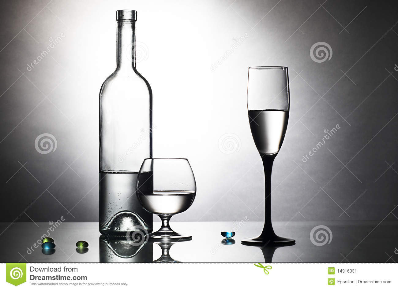 Bottle and two glasses on table