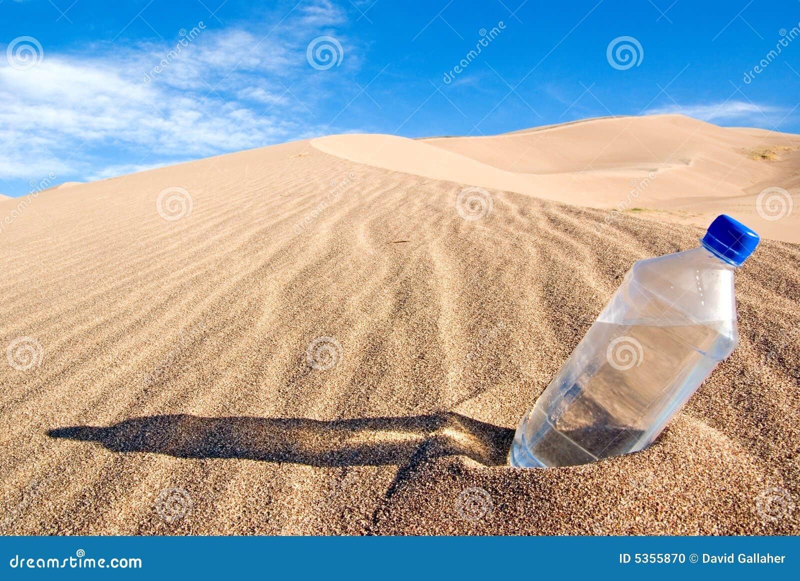 Bottle Of Water In Desert Stock Photo - Image: 5355870