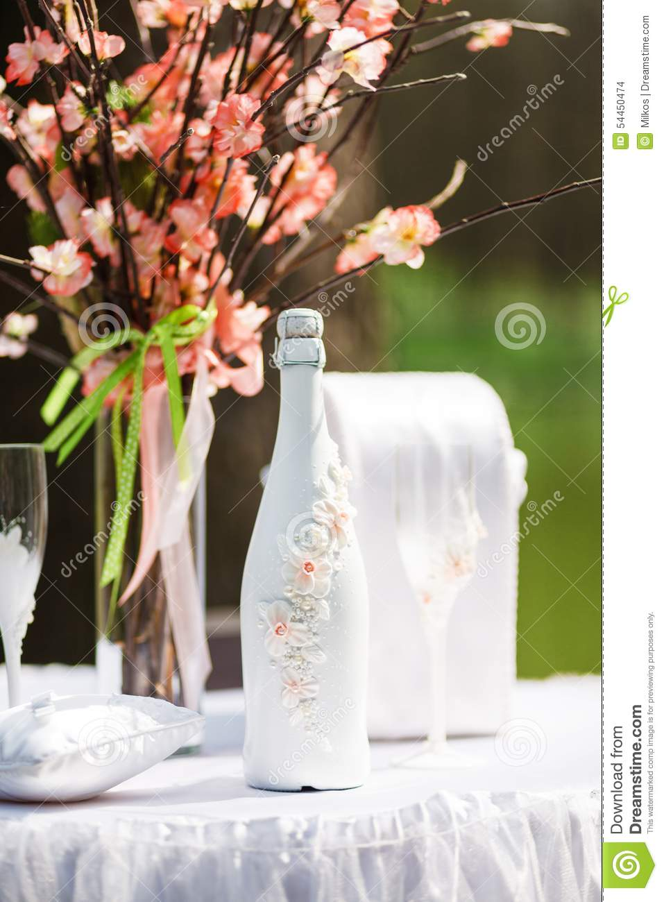 Bottle Of Wedding Champagne Decorated With Flowers Stock Photo