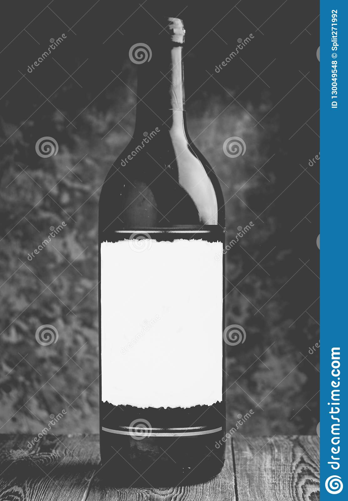 A bottle of white dry wine on a wooden table