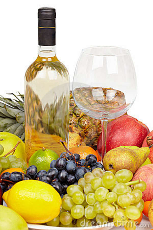 bottle of wine  glass and tropical fruit stock photography