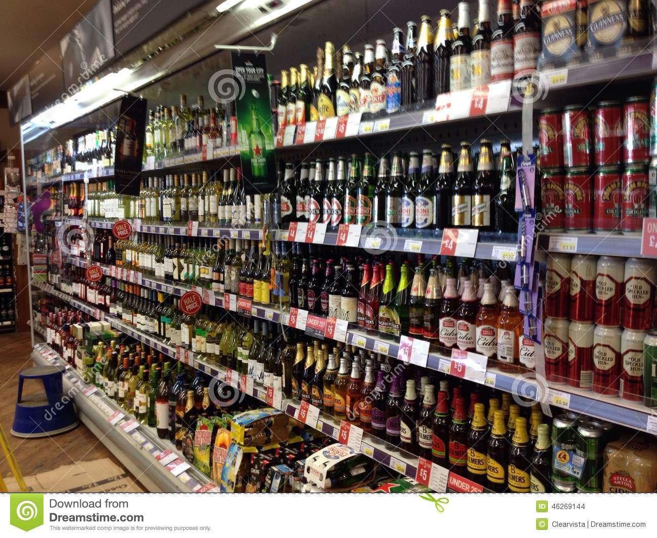 Bottles Of Alcohol In A Display Cabinet Editorial Stock Image ...