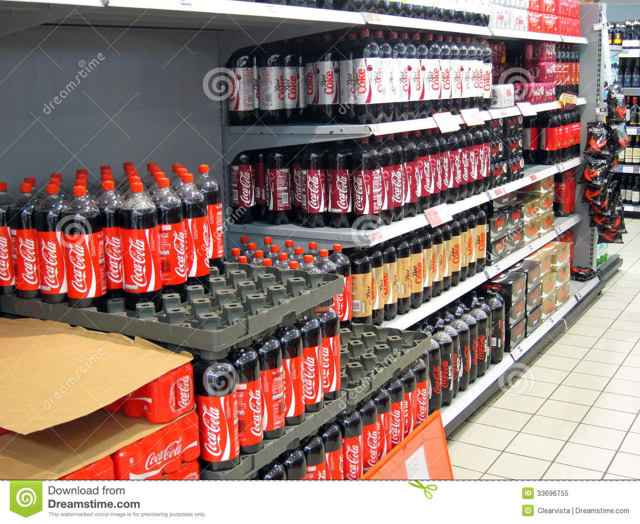 Bottles Of Coca Cola On A Store Shelf Editorial Image