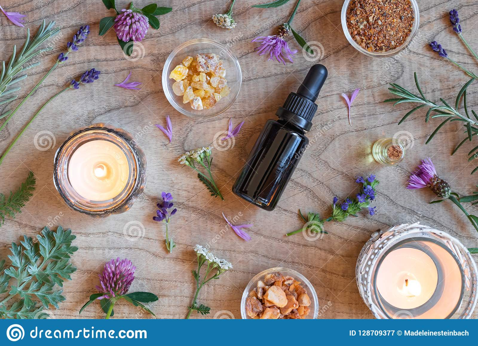 Bottles of essential oil with frankincense, hyssop, wormwood and
