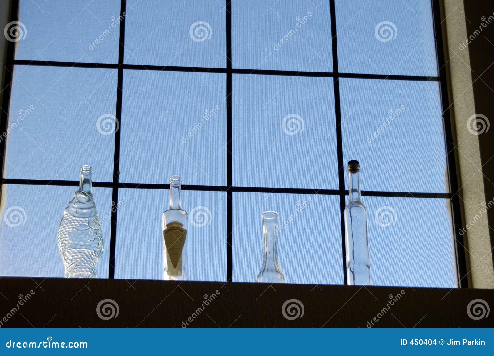 Bottles in a window 2