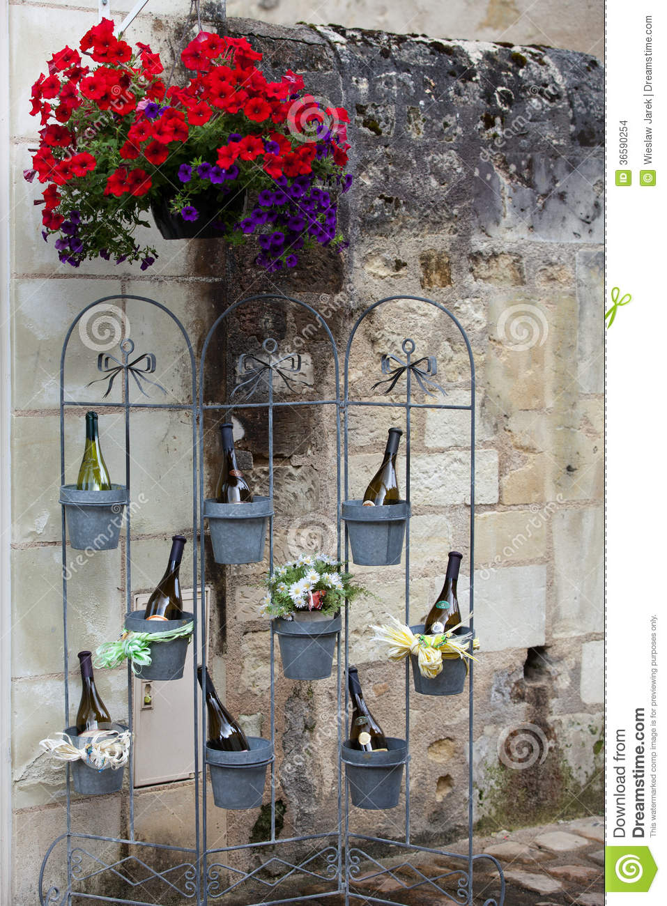 Bottles of wine in flowerpots stock images image 36590254 for Most beautiful wine bottles