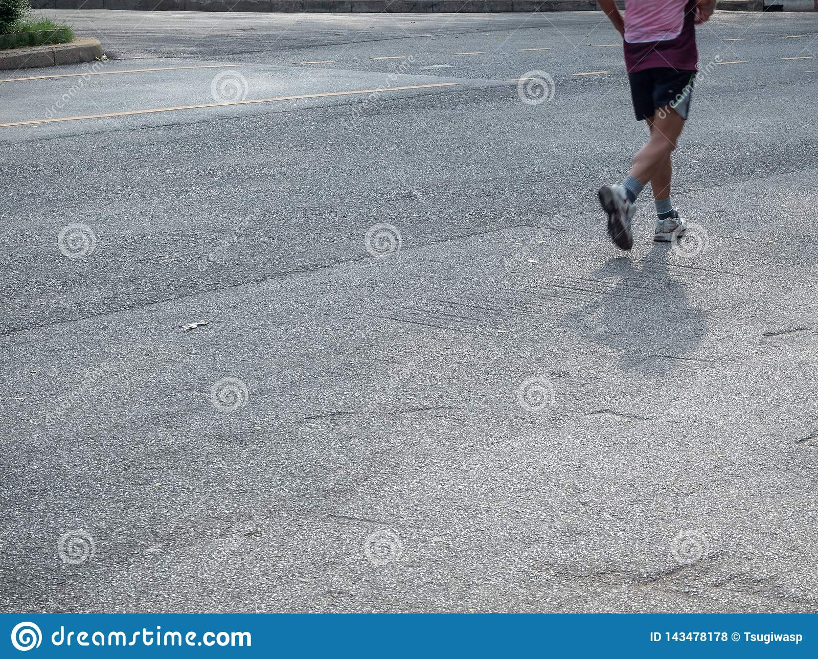 The bottom of the runners who jogging in the park