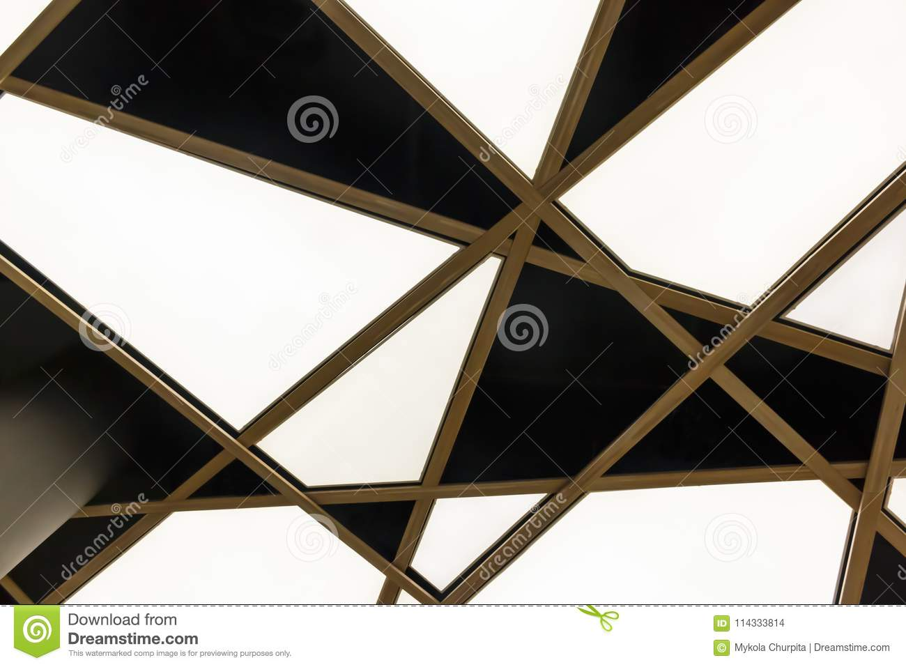 The bottom view of the modern white triangular ceiling