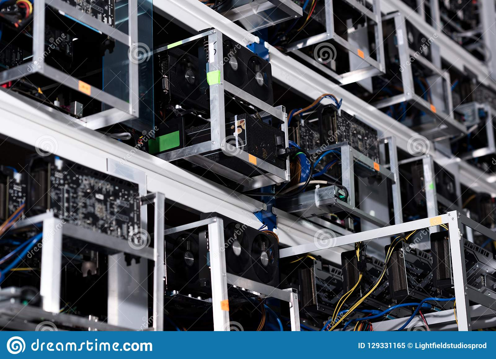 Bottom view of shelves with equipment at ethereum mining farm royalty free stock photo