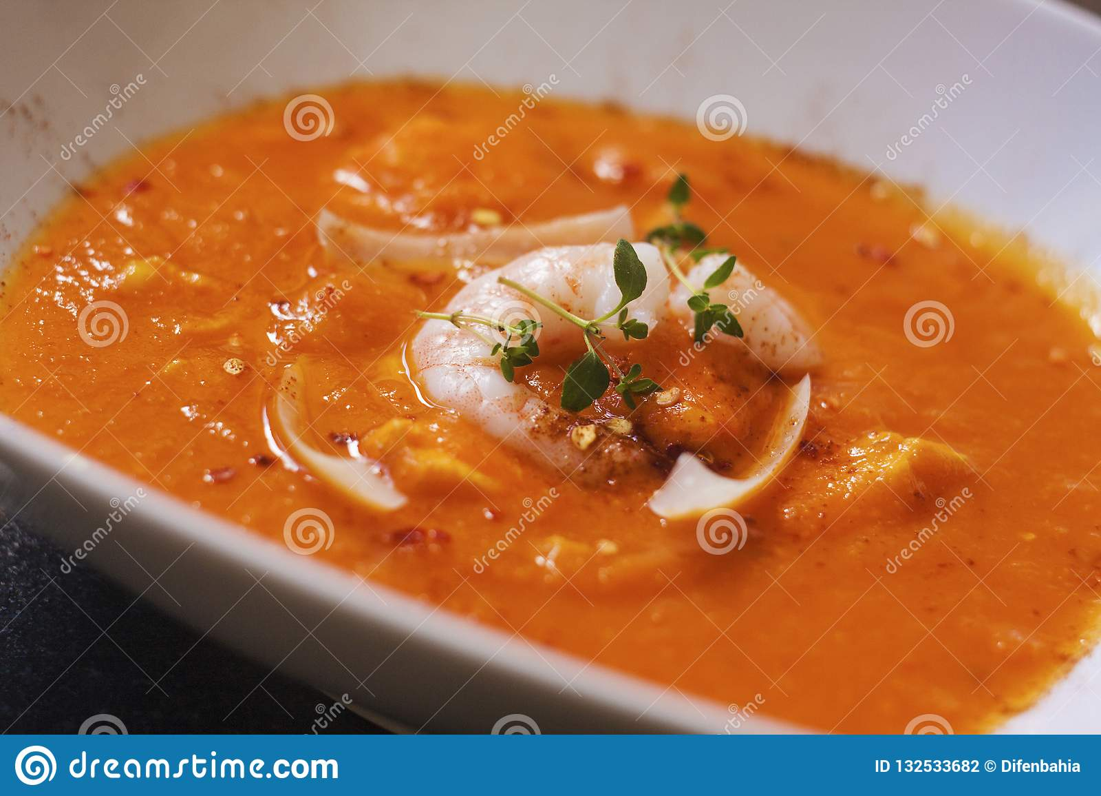 Bouillabaisse soup. Delicious fish soup with shimps, fish fillet and vegetables