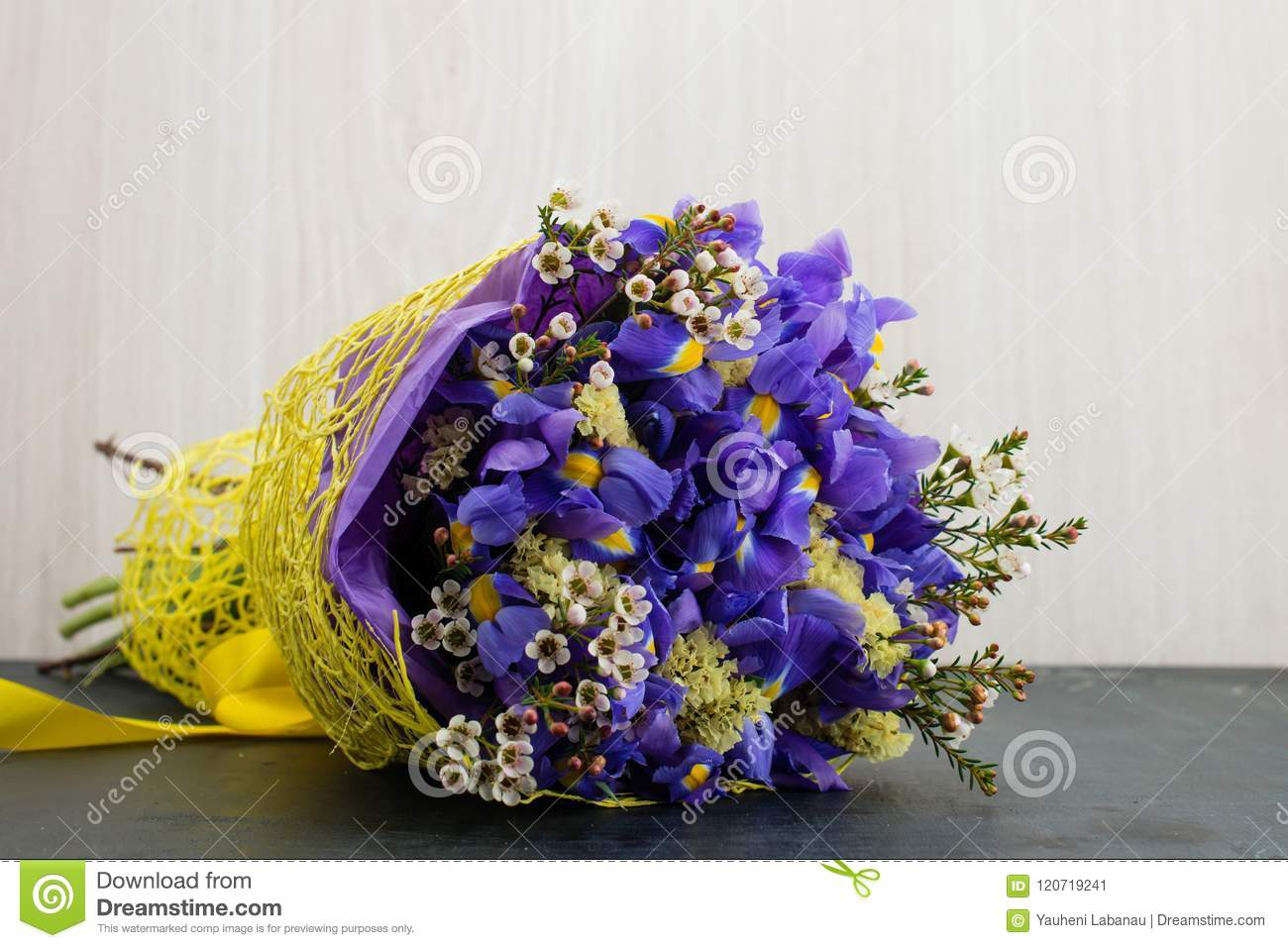 Bouquet of bell flowers stock image image of blossom 120719241 bouquet of blooming blue bell and little yellow flowers wrapped in paper on dark table wooden background izmirmasajfo