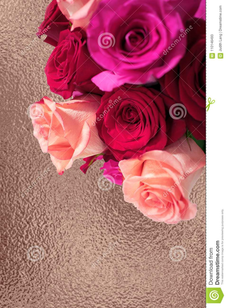 Bouquet of pink and red roses on rose gold background
