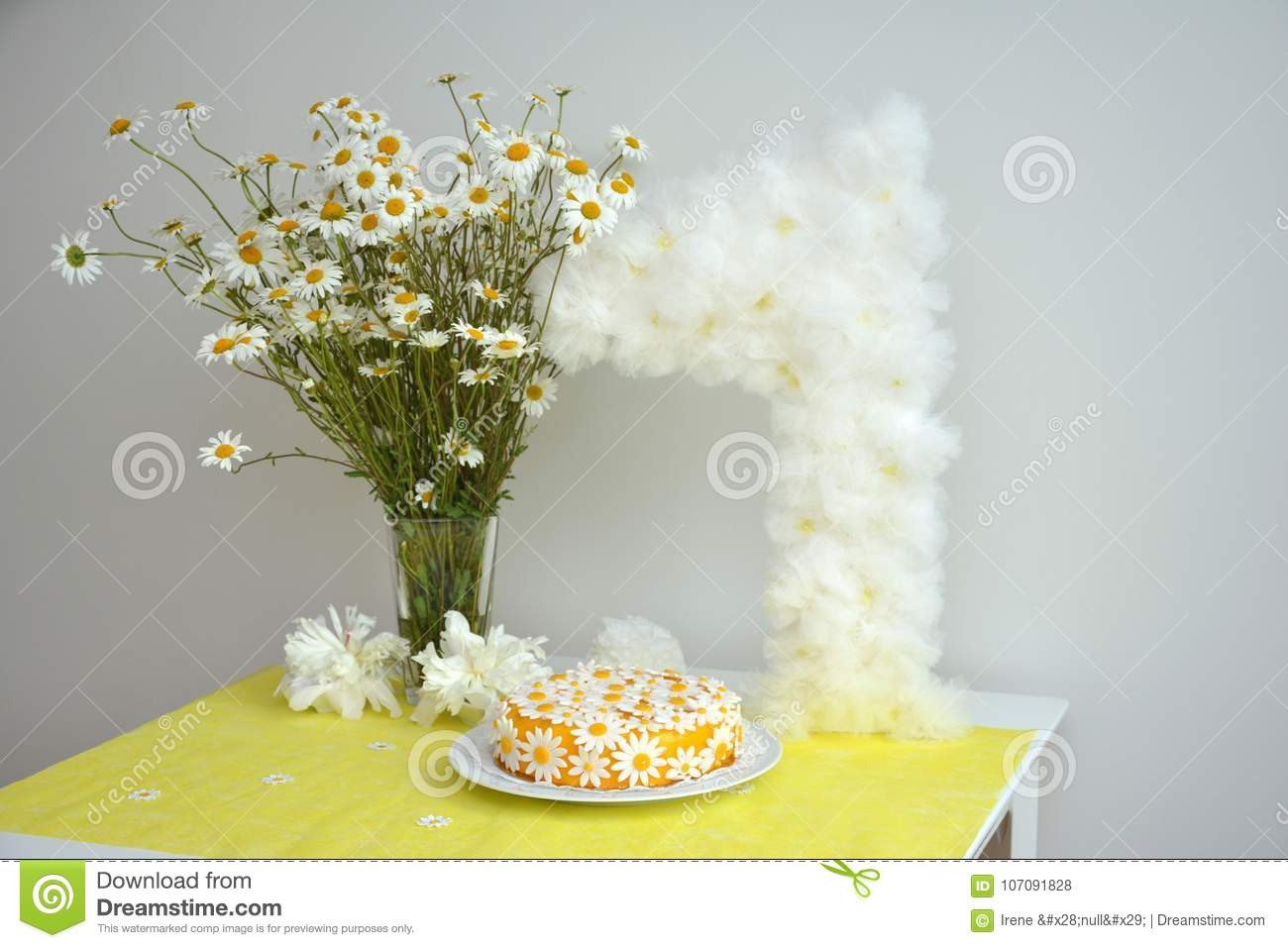 A Bouquet Of Chamomiles And A Birthday Cake For Girls For 1 Year