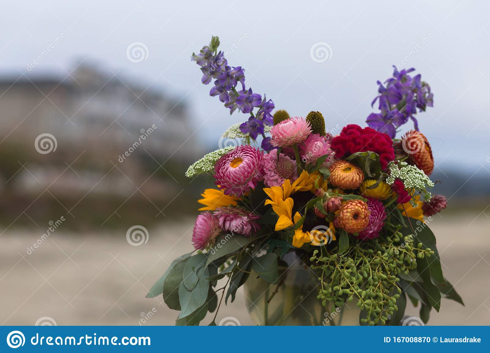 Bouquet Of Chrysanthemums Eucalyptus And Sunflowers On A Sandy Beach Stock Photo Image Of Outdoors Glass 167008870