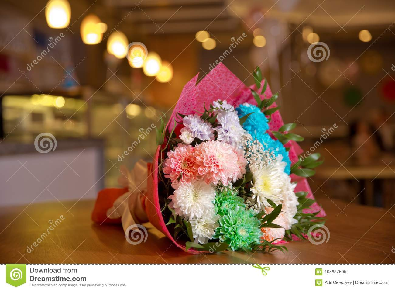 Colored birthday flower bouquet. Bouquet of colorful fresh freesia on a wooden background