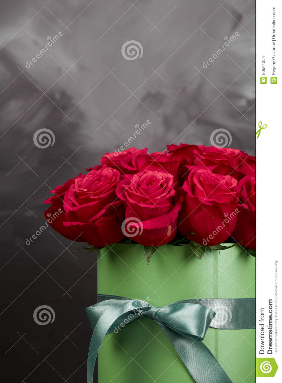 Bouquet Of Delicate Red Roses In Green Gift Box On Dark Grey