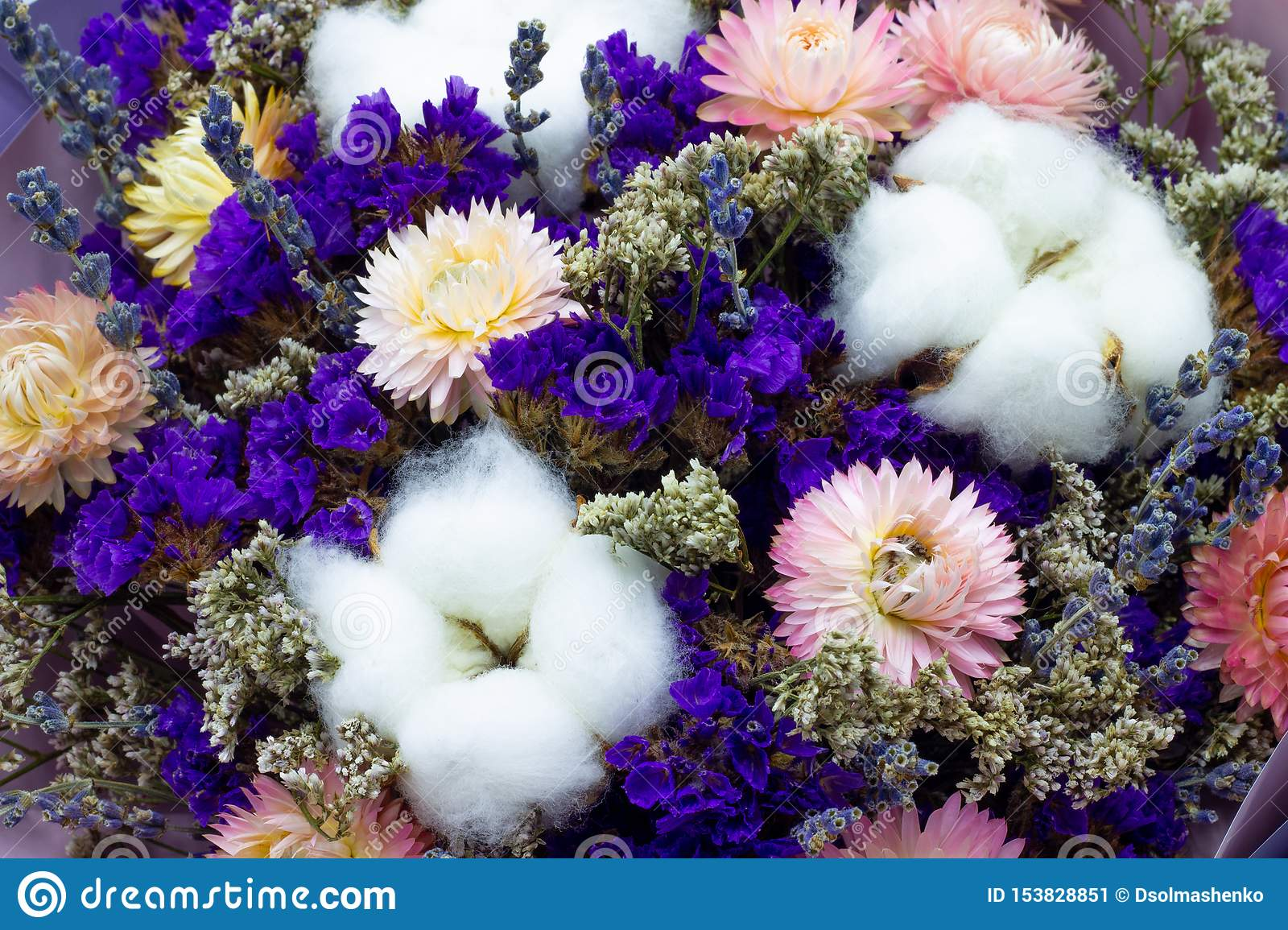 Bouquet of dried flowers with cotton and lavender floral background