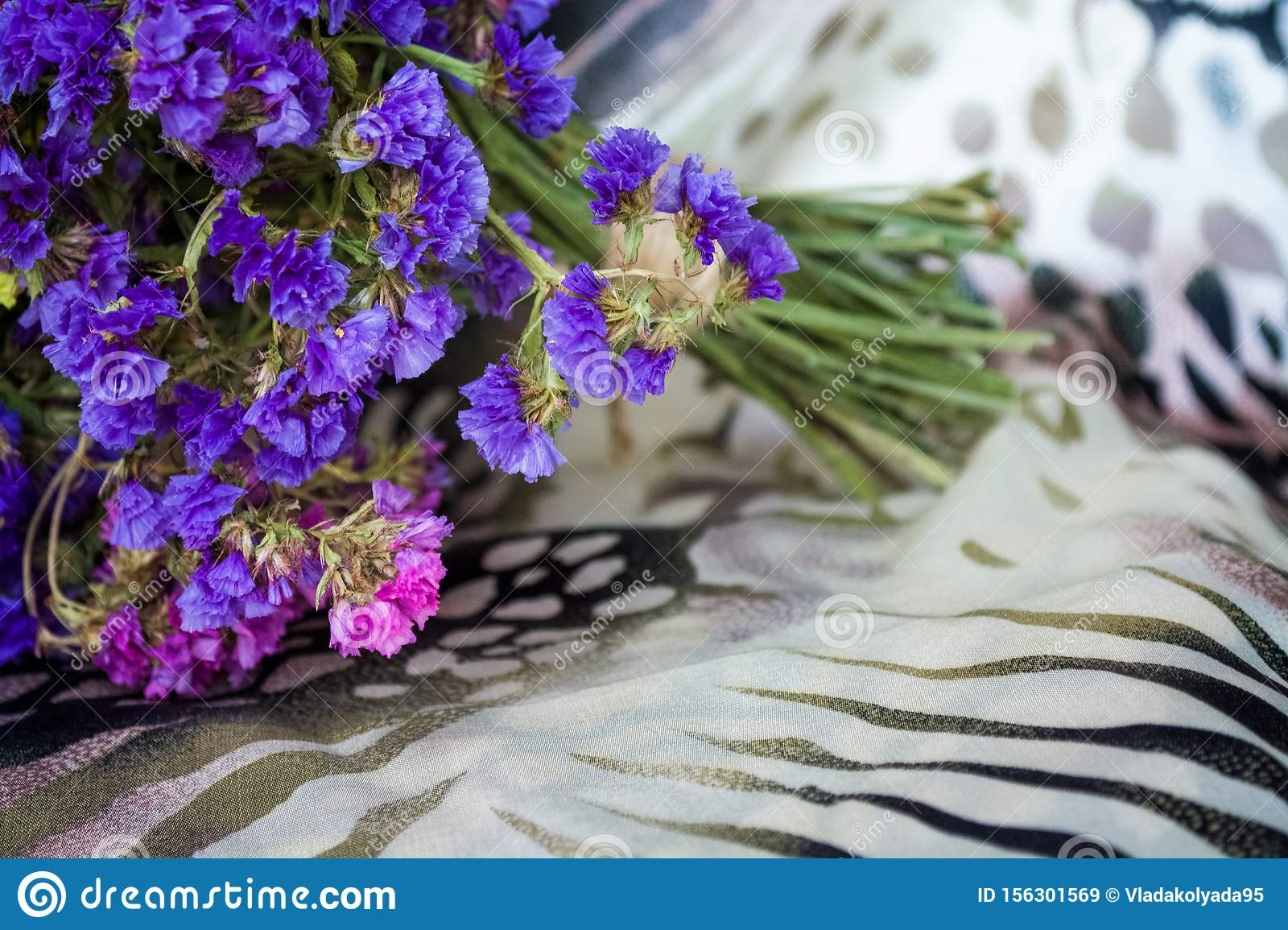 Bouquet Of Field And Arid Flowers On Cloth With Leopard And Zebra Print Stock Image Image Of Garden Color 156301569