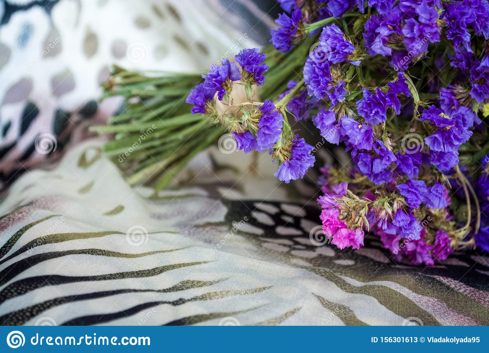 Bouquet Of Field And Arid Flowers On Cloth With Leopard And Zebra Print Stock Image Image Of Flora Flower 156301613