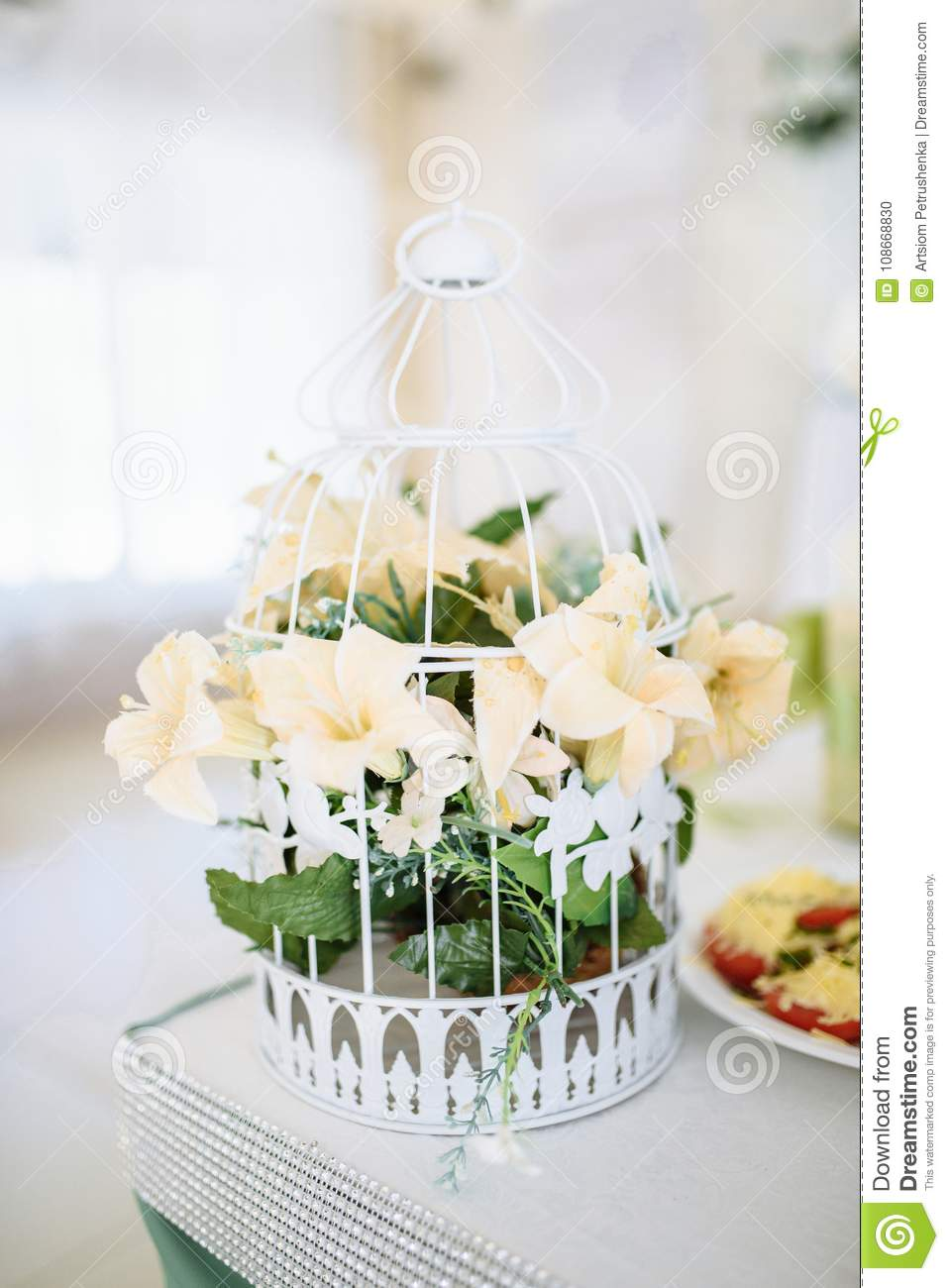 A bouquet of flowers in a decorative cage stock photo image of download a bouquet of flowers in a decorative cage stock photo image of holiday izmirmasajfo
