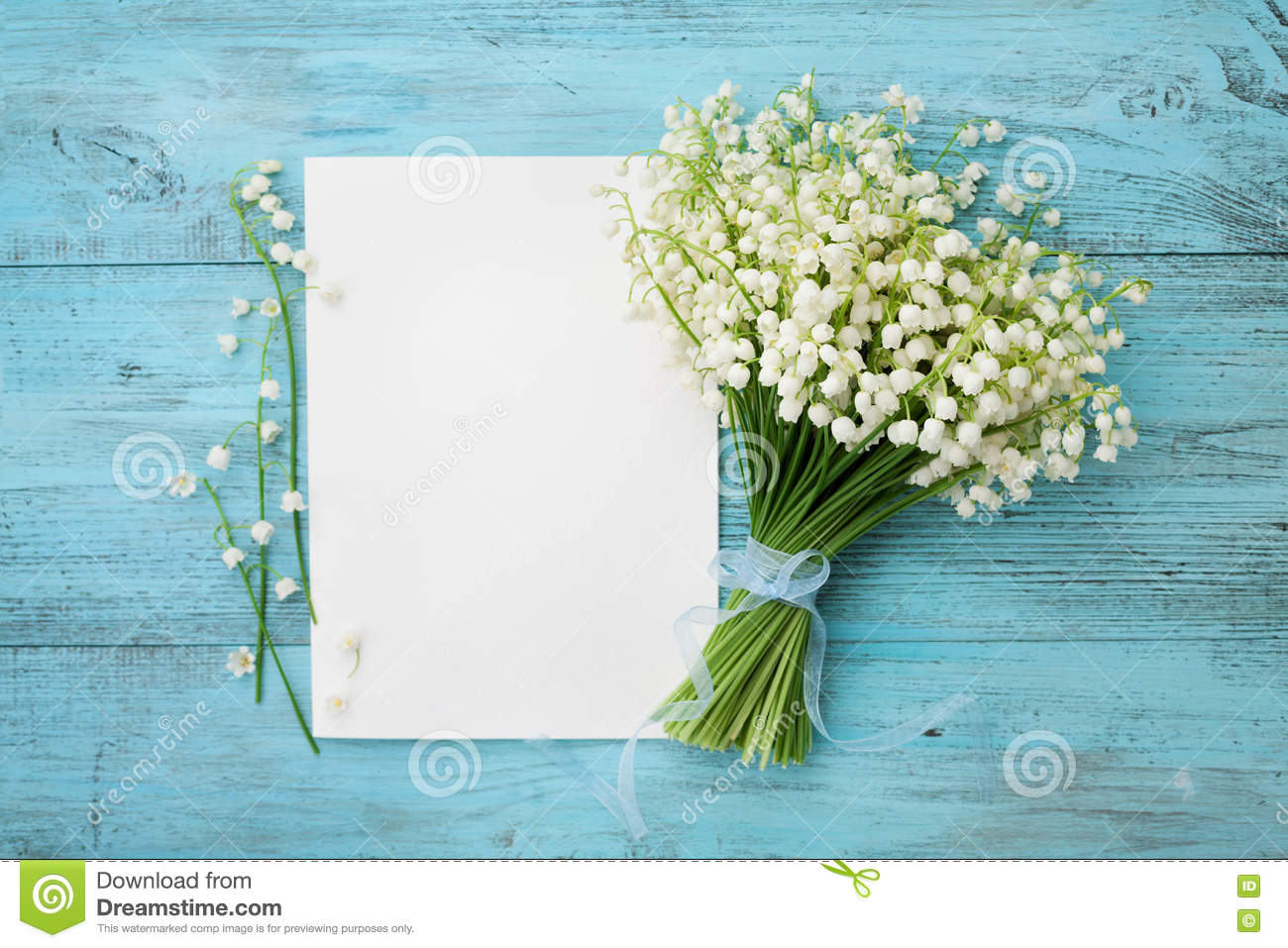 Bouquet of flowers lily of the valley and empty paper sheet on royalty free stock photo download bouquet of flowers lily of the valley izmirmasajfo