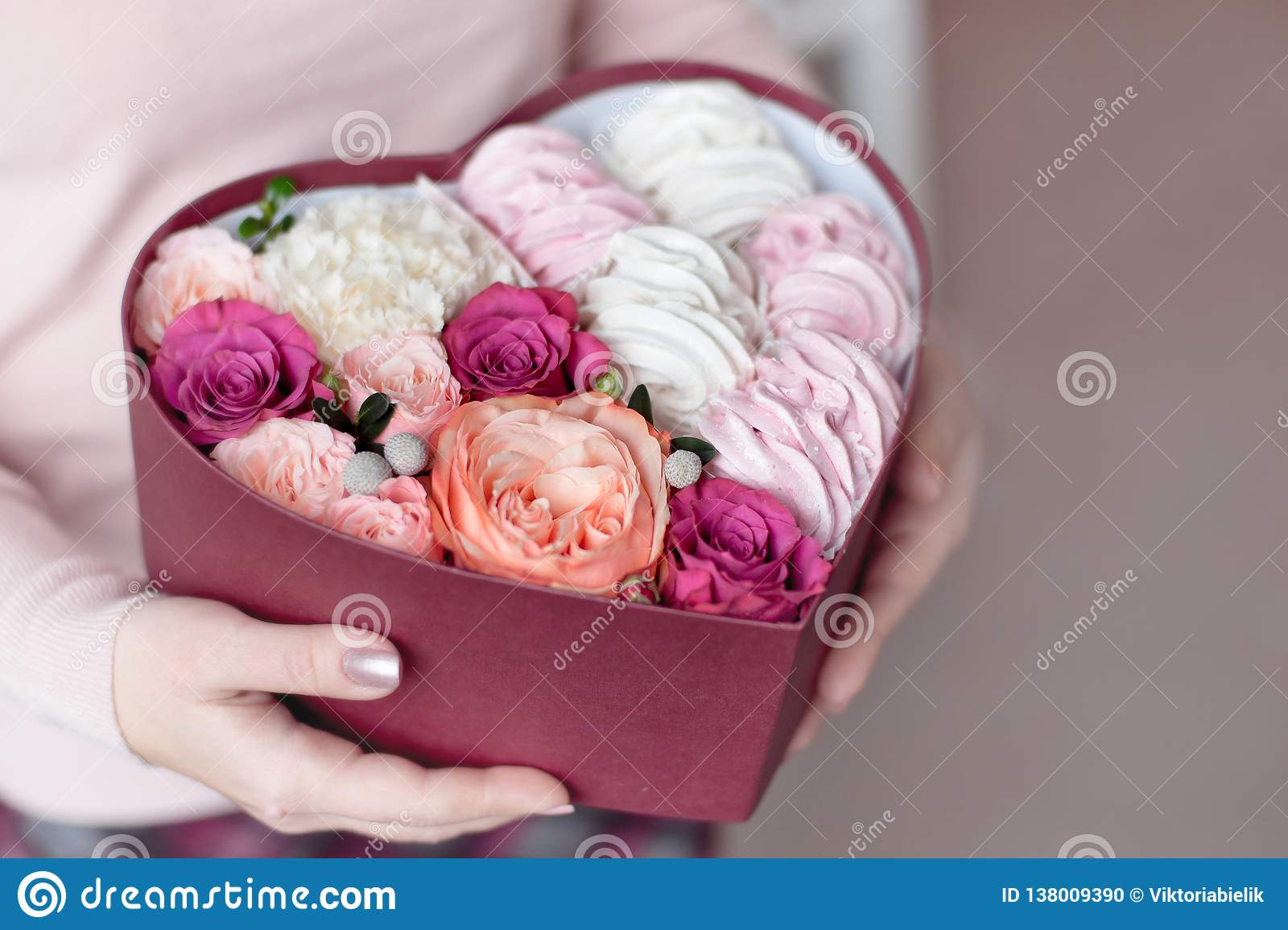 A Bouquet Of Flowers And Marshmallows In A Gift Box Of Heart In Female Hands Congratulatory Concept Sale Stock Photo Image Of Food Celebration 138009390