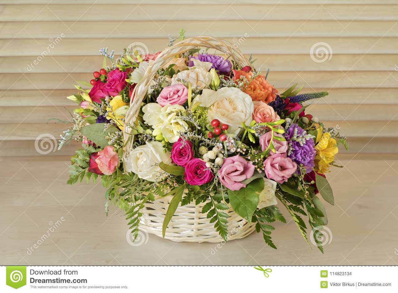 Bouquet Of Flowers Multi Colored Roses With Green Leaves Stands