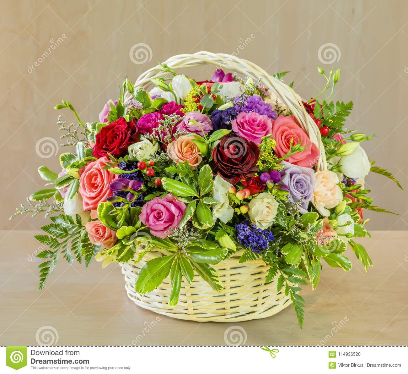 bouquet of flowers multi colored roses in a wicker basket stock rh dreamstime com
