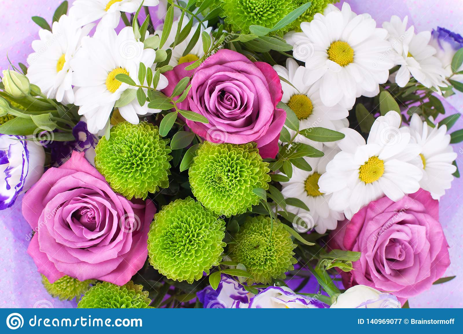 Bouquet of flowers pink roses, white chrysanthemums with green leaves on white background isolated close up