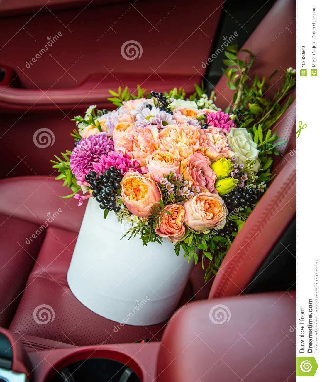 Bouquet Of Flowers Roses Luxury Gift Box In The Car Seat Stock Photo