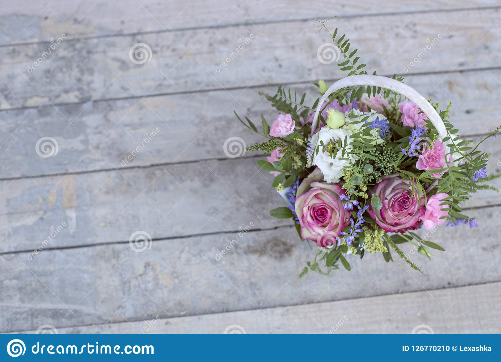Bouquet of flowers in a basket, background. Bouquet of flowers in a white basket, background Stock Photo