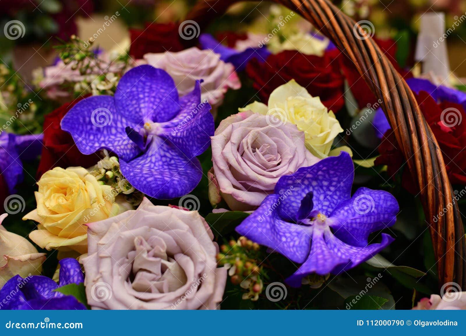 Bouquet of flowers in wicker basket