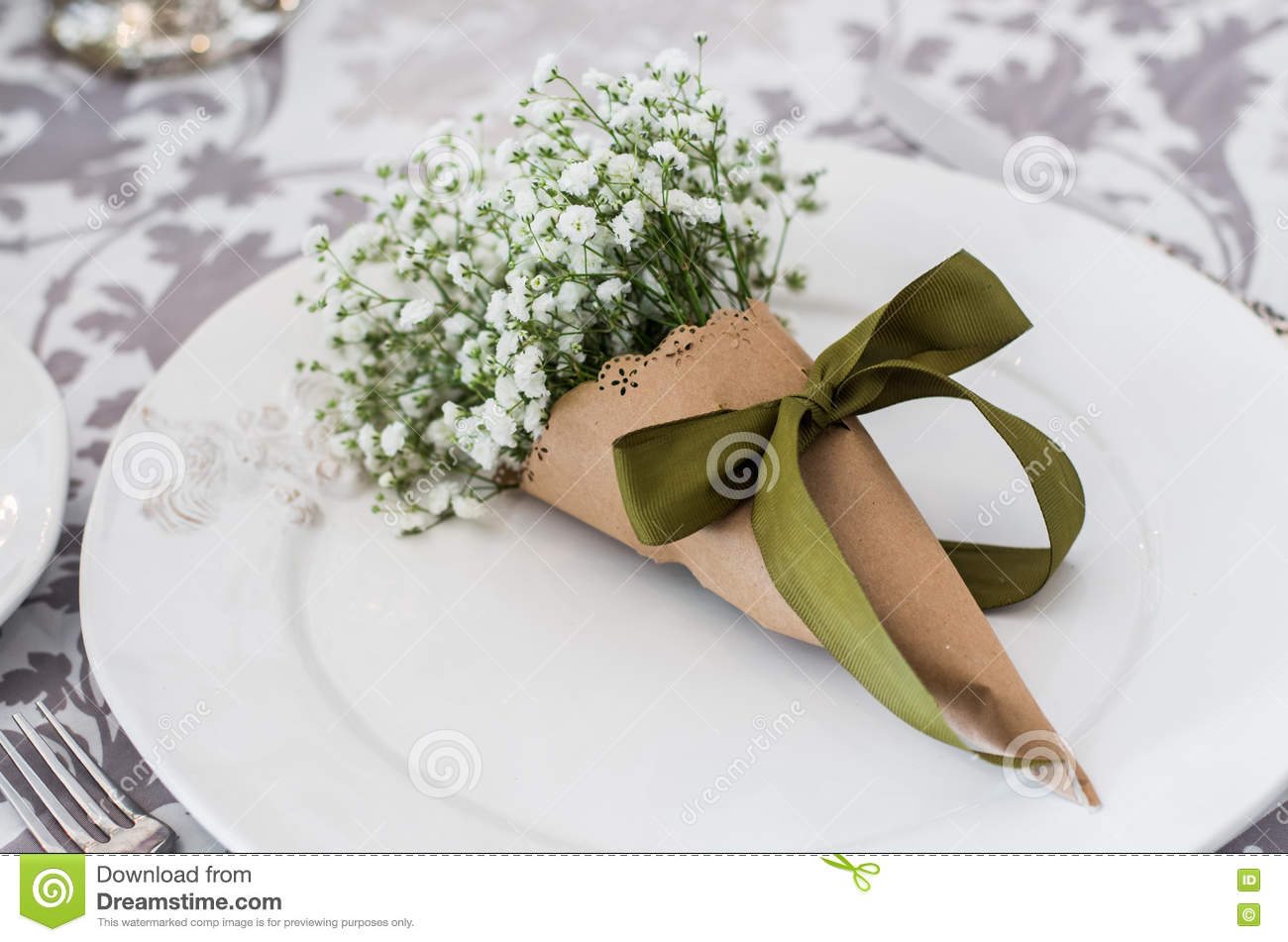 Bouquet Of Gypsophilas On White Plate In Art Paper