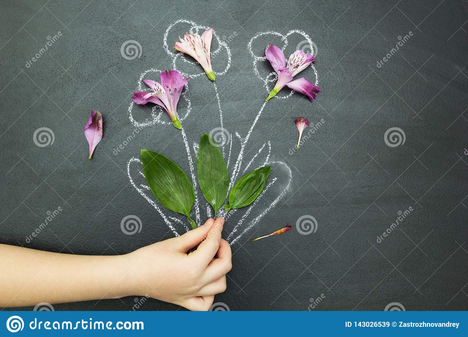 Bouquet in hand on a black background