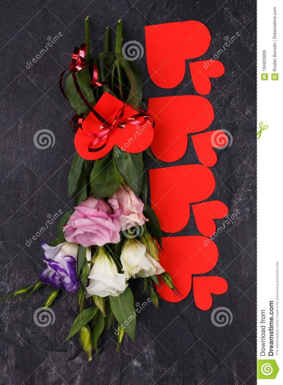 A Bouquet Of Japanese Roses Lies Upside Down On A Stone Background