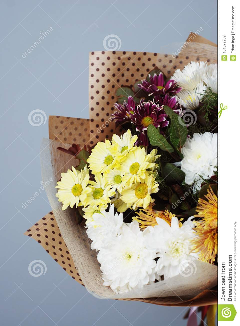 Bouquet in kraft paper a simple bouquet of flowers and greens on download bouquet in kraft paper a simple bouquet of flowers and greens on gray background izmirmasajfo