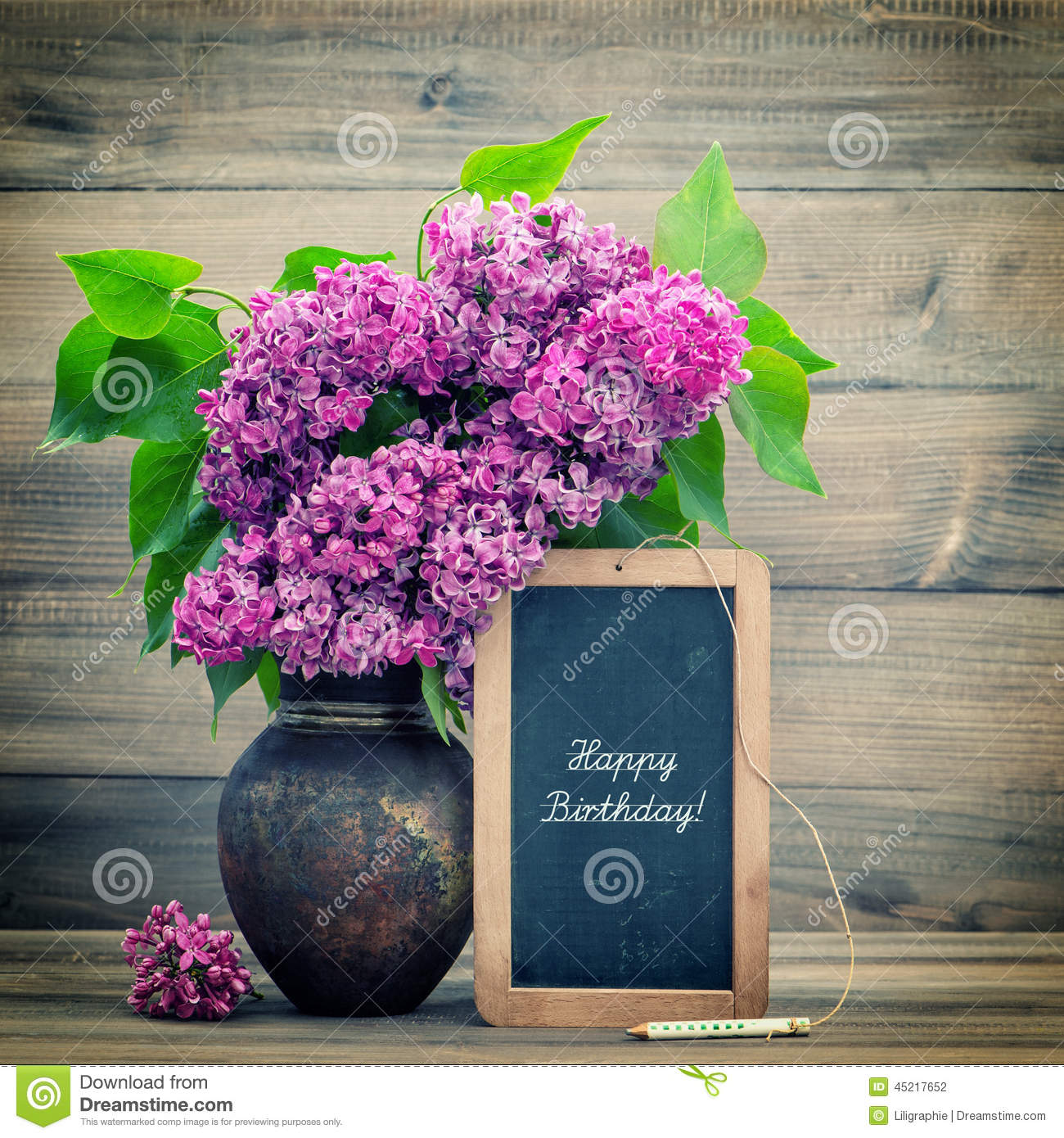 Download Bouquet Of Lilac Flowers Blackboard With Text Happy Birthday Stock Photo
