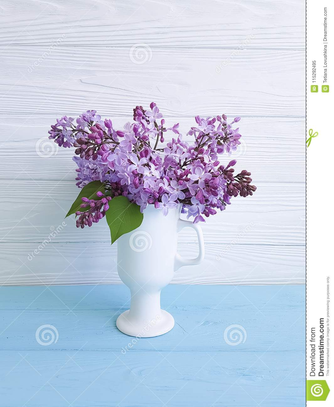 Bouquet of lilac in a vase on a wooden