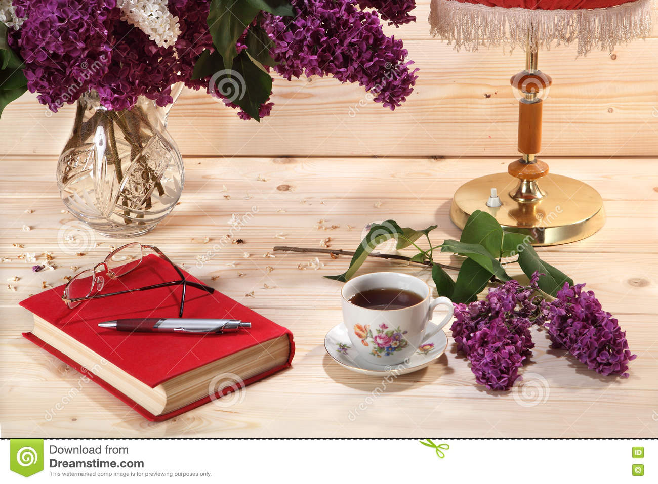 Bouquet of lilacs book spectacles cup of tea and table lamp bouquet of lilacs book spectacles cup of tea and table lamp geotapseo Image collections